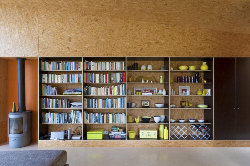 A wide book shelf displaying Vicky's ceramics
