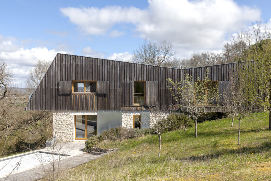 Exterior of the house, which cantilevers over the valley