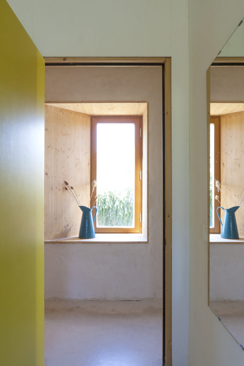A hallway window with views onto the countryside