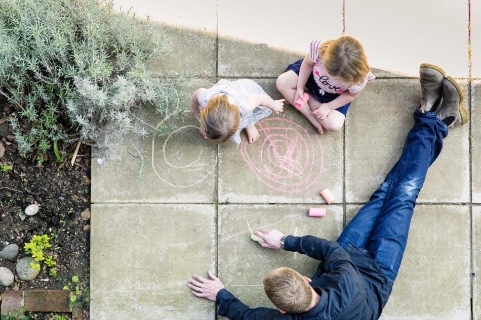 Richard playing with his children in the garden