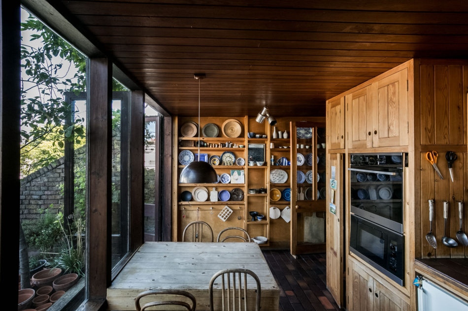 the kitchen with wooden details