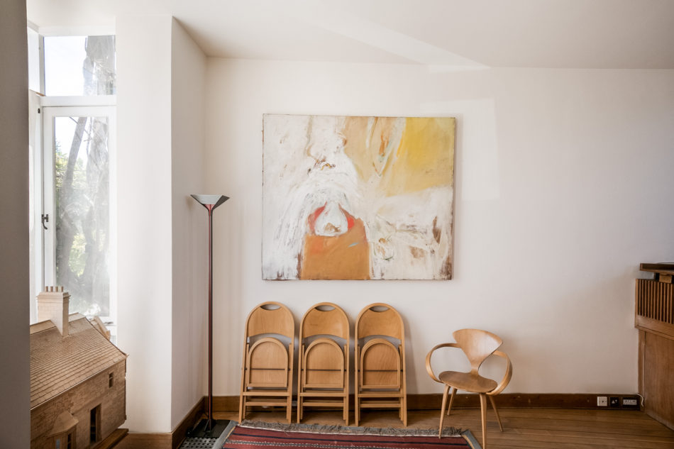 the living room with abstract art