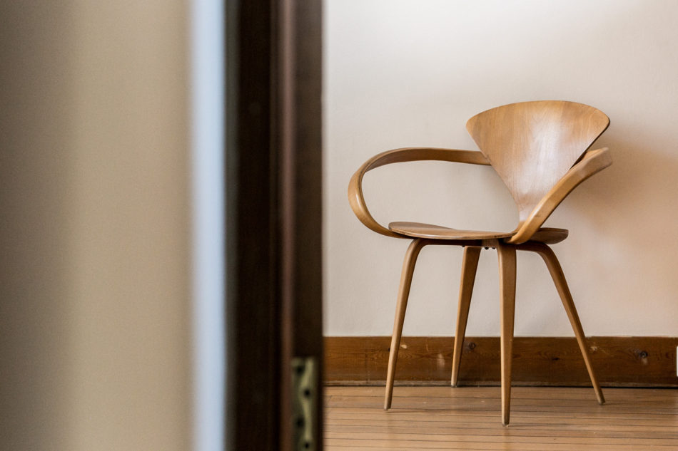 a wooden chair in the living room